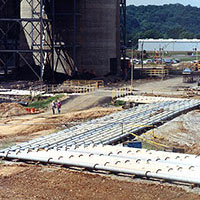 """ABRESIST® pipe with 10"""" and 12"""" ID rests on treated lumber supports. AEP laid 4000' of 10"""" and 2500' of 12"""" Abresist basalt lined pipe when it installed scrubbers recently at its Gavin Power Plant."""